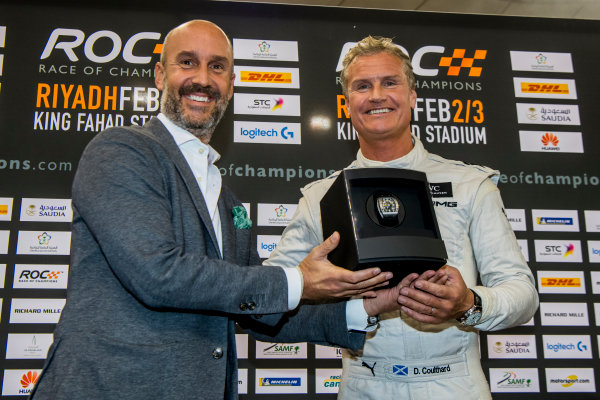 2018 Race Of Champions King Farhad Stadium, Riyadh, Abu Dhabi. Saturday 3 February 2018 Winner David Coulthard (GBR) is presented with a Richard Mille watch on the podium. Copyright Free FOR EDITORIAL USE ONLY. Mandatory Credit: 'Race of Champions'