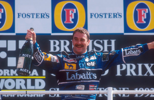 1992 British Grand Prix.Silverstone, England.10-12 July 1992.Nigel Mansell (Williams Renault) celebrates 1st position on the podium.Ref-92 GB 02.World Copyright - LAT Photographic