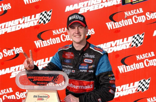 2002 NASCAR,Martinsville Speedway,Virginia,USA,Old Dominion 500, October 18-20, 2002 USA-Kurt Busch poses by the winning trophy,Copyright-Robt LeSieur2002LAT Photographic