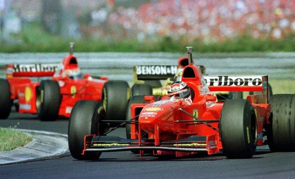 1997 Hungarian Grand Prix.Hungaroring, Budapest, Hungary.8-10 August 1997.Michael Schumacher (Ferrari F310B) leads his brother Ralf (Jordan 197 Peugeot) and Eddie Irvine (Ferrari F310B).World Copyright - LAT Photographic