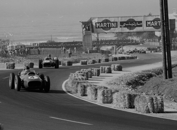 1958 Moroccan Grand Prix. Ain-Diab, Casablanca, Morocco. 17-19 October 1958. Phil Hill leads Mike Hawthorn (both Ferrari Dino 246). Hill allowed Hawthorn to pass him to clinch the World Championship. They finished in 3rd and 2nd positions respectively. World Copyright - LAT Photographic