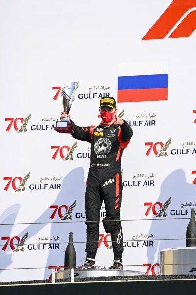 Nikita Mazepin (RUS, HITECH GRAND PRIX) celebrates on the podium with the trophy