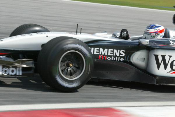 2003 Malaysian Grand Prix. Sepang, Kuala Lumpur, Malaysia.21-23 March 2003.Kimi Raikkonen (McLaren MP4/17D Mercedes) 1st position for his maiden Grand Prix win.World Copyright - LAT Photographic ref: Digital Image Only