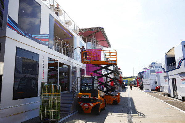 The Williams team prepare their hospitality unit in the paddock.