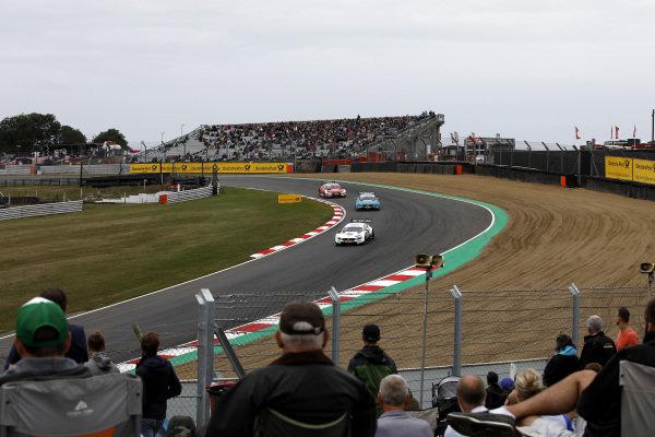 Paul Di Resta, Mercedes-AMG Team HWA, Mercedes-AMG C63 DTM leads Gary Paffett, Mercedes-AMG Team HWA, Mercedes-AMG C63 DTM, René Rast, Audi Sport Team Rosberg, Audi RS 5 DTM.