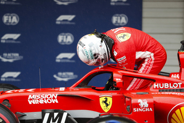 Sebastian Vettel, Ferrari, exits his car in parc ferme.
