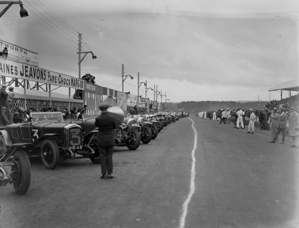 The drivers lined up ready to run to their cars for the start.