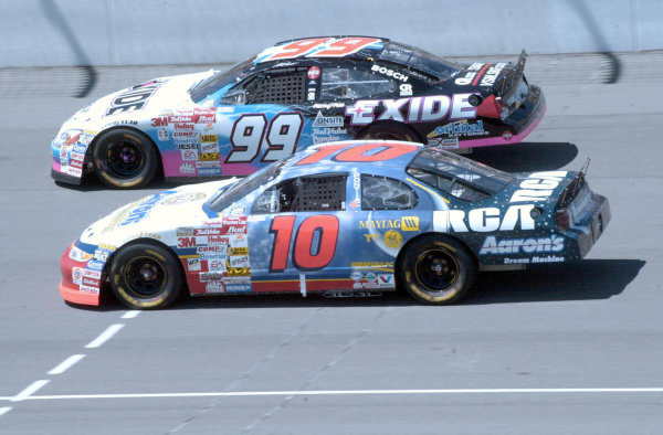 2000 NASCAR Pepsi 400 Michigan Aug19 2000 USAJohnny Benson (10) aside Jeff Burton (99) at speed-Robt LeSieur2000LAT Photographic