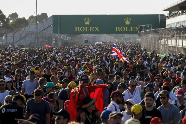 Fans flood the circuit after the race