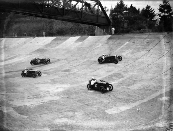 An Austin 7 (#17) and a MG (#8) battle with Frazer Nashes during the Junior Mountain Handicap.