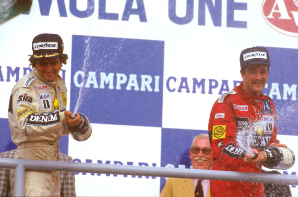 Hockenheim, Germany. 25-27 July 1986. Nelson Piquet, 1st position with teammate Nigel Mansell, 3rd position (both Williams Honda) on the podium.  Ref-86 GER 09. World Copyright - LAT Photographic