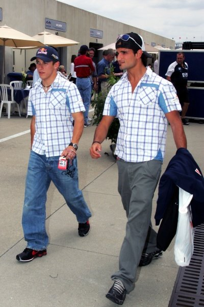 (L to R): Christian Klien (AUT) Red Bull Racing and Vitantonio Liuzzi (ITA) Red Bull Racing leave the Paddock.  Formula One World Championship, Rd 9, United States Grand Prix, Race, Indianapolis, USA, 19 June 2005. DIGITAL IMAGE