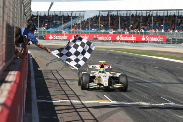 Silverstone, England. 11th July.Sunday Race. Sergio Perez (MEX, Barwa Addax Team) crosses the line to take victory. Action. Photo: Jakob Ebrey/GP2 Media Service.Ref: _MKO_9217 jpg