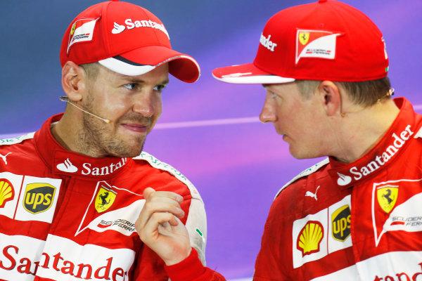 Marina Bay Circuit, Singapore. Sunday 20 September 2015. Sebastian Vettel, Ferrari, 1st Position, and Kimi Raikkonen, Ferrari, 3rd Position, in the Press Conference. World Copyright: Alastair Staley/LAT Photographic. ref: Digital Image _R6T7453