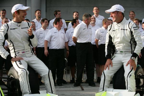 Sepang, Kuala Lumpur, Malaysia2nd April 2009Jenson Button, Brawn GP BGP001 Mercedes and Rubens Barrichello, Brawn GP BGP001 Mercedes share a laugh at the team shot.World Copyright: Glenn Dunbar/LAT Photographicref: Digital Image YY8P0533