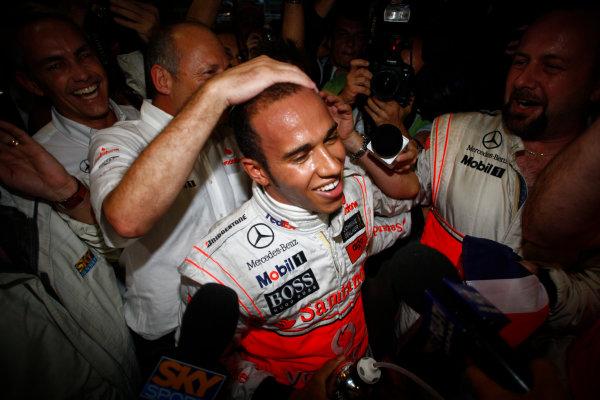 Interlagos, Sao Paulo, Brazil2nd November 2008Lewis Hamilton, McLaren MP4-23 Mercedes, 5th position, celebrates his world title with his team. Portrait. Finish.World Copyright: Steven Tee/LAT Photographic ref: Digital Image _I4V5005