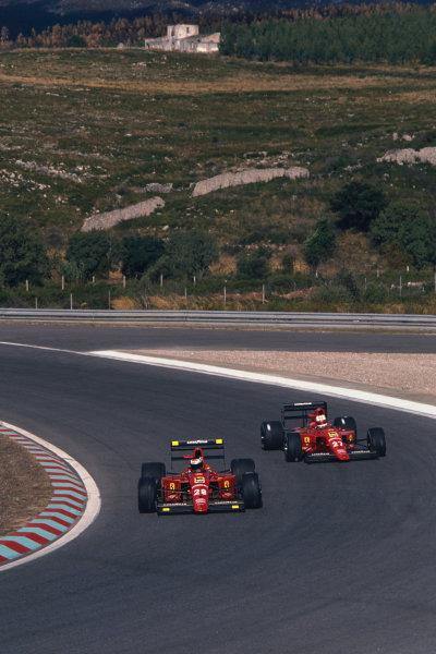 1989 Portuguese Grand Prix  Estoril, Portugal. 22-24 September 1989.  Gerhard Berger and Nigel Mansell, both Ferrari 640.  Ref: 89POR13. World copyright: LAT Photographic