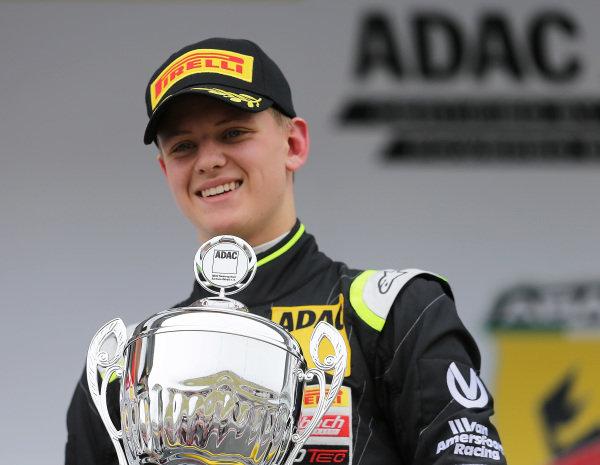 Race two winner Mick Schumacher (GER) Van Amersfoort Racing celebrates on the podium with the trophy at German Formula Four Championship, Rd1, Oschersleben, Germany, 24-26 April 2015.