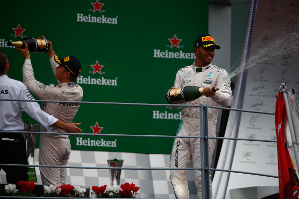 Autodromo Nazionale di Monza, Italy. Sunday 4 September 2016. Lewis Hamilton, Mercedes AMG, 2nd Position, sprays Champagne from the podium. World Copyright: Andy Hone/LAT Photographic ref: Digital Image _ONZ7000