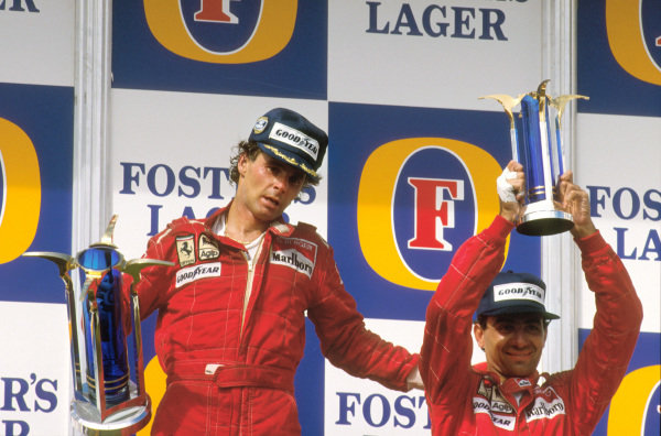 Adelaide, Australia.13-15 November 1987.Gerhard Berger, 1st position gives teammate Michele Alboreto, 3rd position (both Ferrari) a pat on the back whilst on the podium.Ref-87 AUS 10.World Copyright - LAT Photographic