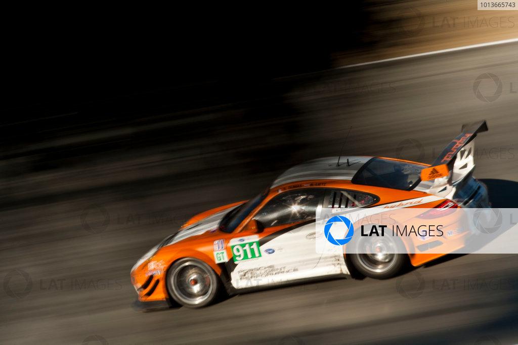 American Le Mans Series. Laguna Seca, Monterey, California. 15th - 17th September 2011. Romain Dumas / Richard Lietz, Porsche Motorsports North America, Porsche GT3R Hybrid. Action. Photo: Drew Gibson/LAT Photographic. ref: Digital Image _Y8P4448
