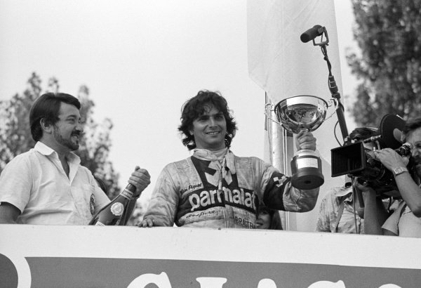 Race winner Nelson Piquet (BRA) Brabham, celebrates on the podium his victory in the supporting BMW Procar race which secured him the championship.Formula One World Championship, Italian Grand Prix, Rd 12, Imola, September 14 1980.