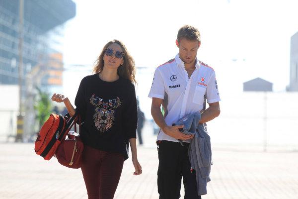 Korea International Circuit, Yeongam-Gun, South Korea. Saturday 5th October 2013. Jenson Button, McLaren, with Jessica Michibata. World Copyright: Charles Coates/LAT Photographic. ref: Digital Image _X5J9318