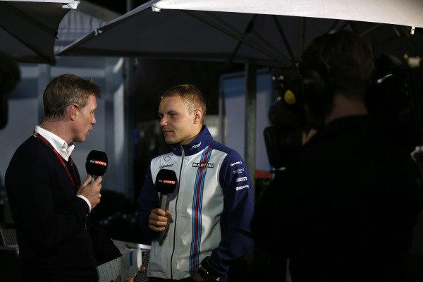 Albert Park, Melbourne, Australia. Friday 13 March 2015. Valtteri Bottas, Williams F1, talks to Simon Lazenby, Sky Sports. World Copyright: Alastair Staley/LAT Photographic. ref: Digital Image _R6T0170