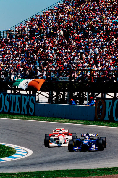 Barcelona, Spain.12-14 May 1995.Olivier Panis (Ligier JS41 Mugen-Honda) followed by Nigel Mansell (McLaren MP4/10B Mercedes). This was Nigel Mansell's last Grand Prix.Ref-95 ESP 12.World Copyright - LAT Photographic