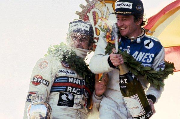 Race winner Patrick Depailler (FRA) Ligier (Right) celebrates with second placed Carlos Reutemann (ARG) Lotus (Left) on the podium. Spanish Grand Prix, Rd 5, Jarama, Spain, 29 April 1979. BEST IMAGE