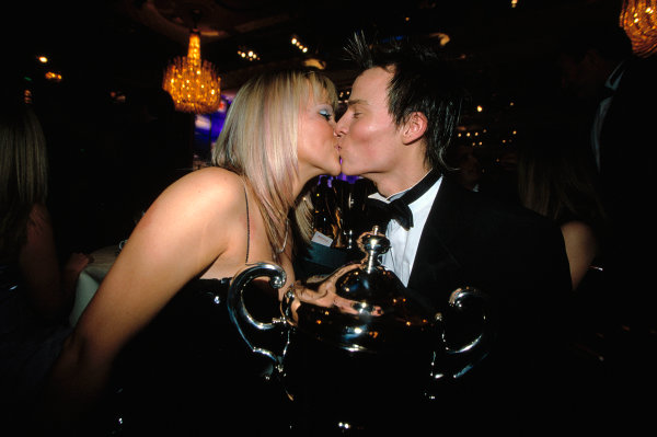 2003 Autosport AwardsGrosvenor Hotel, London, EnglandMcLaren Autosport Young Driver 2003 award winner Alex Lloyd gets a kiss from his girlfriend as he holds the trophy.World Copyright: Griffiths/LATref: 35mm Transparency (30mb scan)