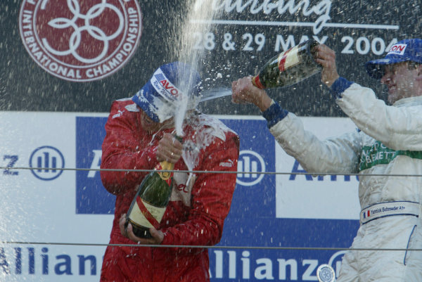 2004 Formula 3000 Championship (F3000) Nurburgring, Germany.29th May 2004. Yannick Schroeder (Durango Formula) gives winner Enrico Toccacelo (BCN F3000) a champagne shower.World Copyright: LAT Photographic ref: Digital Image Only