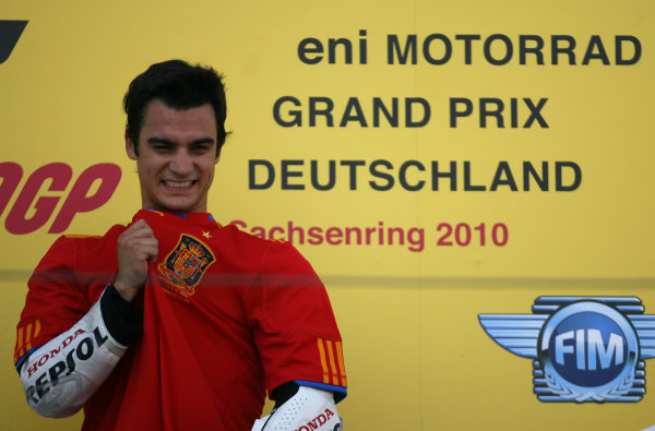 Germany Sachsenring 16-18 July 2010Dani Pedrosa celebrates with the Spanish World Cup shirt on the podium