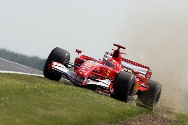 2006 British Grand Prix - Friday Practice Silverstone, England. 8th - 11th June. Michael Schumacher, Ferrari 248F1, action. World Copyirhgt: Jakob Ebrey/LAT Photographic ref: Digital Image JEB23504