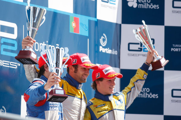 Sunday Race.Luca Filippi (ITA, Super Nova Racing) celebrates his victory on the podium with Sergio Perez (MEX, Telmex Arden International) and Javier Villa (ESP, Super Nova Racing). World Copyright: Alastair Staley / GP2 Series Media Service.Ref: _O9T3901 jpg