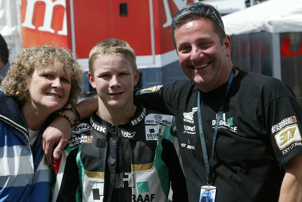 2008 Moto GP ChampionshipEstoril, Portugal. 12th - 13th April 2008Danny Webb Deegraf Aprilia celebrates his front row start for the 125cc race with his Mum and Dad.World Copyright: Martin Heath/LAT Photographicref: Digital Image Only
