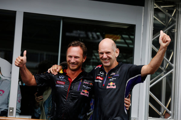 Spa-Francorchamps, Spa, Belgium. Saturday 23 August 2014. Christian Horner, Team Principal, Red Bull Racing, and Adrian Newey, Chief Technical Officer, Red Bull Racing, after doing the Ice Bucket Challenge. World Copyright: Charles Coates/LAT Photographic. ref: Digital Image _J5R1169