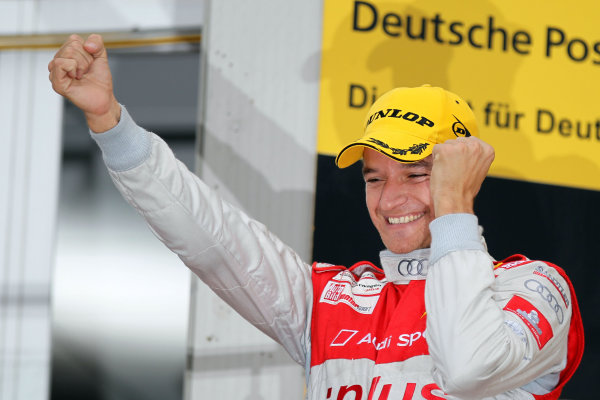 Race winner Timo Scheider (GER), Audi Sport Team Abt celebrates on the podium.