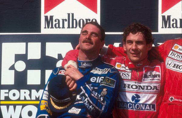 1992 Hungarian Grand Prix.Hungaroring, Budapest, Hungary.14-16 August 1992.Nigel Mansell (Williams Renault) celebrates 2nd position on the podium and winning the drivers World Championship, with Ayrton Senna (McLaren Honda) 1st position.Ref-92 HUN 12.World Copyright - LAT Photographic