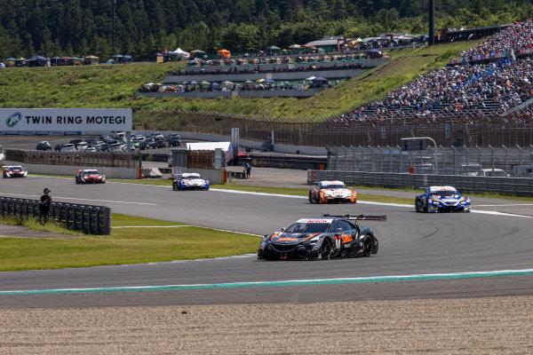 GT500 Winner Naoki Yamamoto & Tadasuke Makino, Stanley Team Kunimitsu, Honda NSX-GT GT500, leads the field