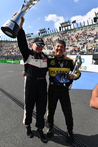 Race winner Katsuaki Kubota (JPN) and Gregory Thornton (GBR) celebrate with the trophies at Masters Historics, Circuit Hermanos Rodriguez, Mexico City, Mexico, 29 October 2016.