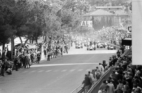Lorenzo Bandini, Ferrari 312 leads Jack Brabham, Brabham BT19 Repco and John Surtees, Honda RA273 at the start of the race.