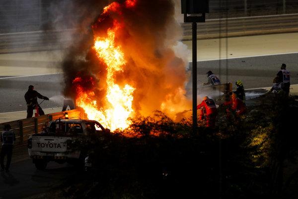 The crashed car of Romain Grosjean, Haas VF-20 on fire