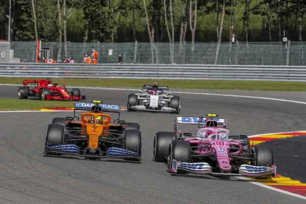 Lance Stroll, Racing Point RP20, leads Nicholas Latifi, Williams FW43, and Pierre Gasly, AlphaTauri AT01, and Sebastian Vettel, Ferrari SF1000