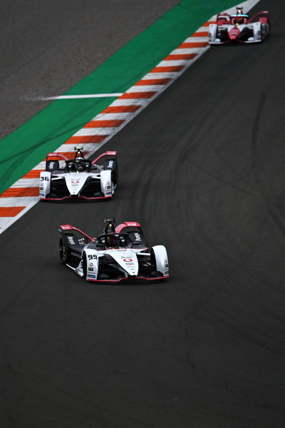 Pascal Wehrlein (DEU), Tag Heuer Porsche, Porsche 99X Electric, leads Andre Lotterer (DEU), Tag Heuer Porsche, Porsche 99X Electric, and Sergio Sette Camara (BRA), Dragon Penske Autosport, Penske EV-5