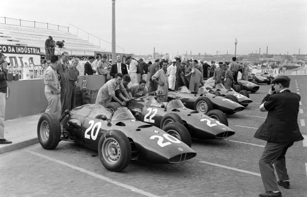 Mechanics push Graham Hill and his BRM P48 out of the pits.