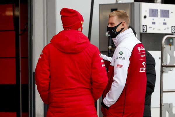 Mick Schumacher, Alfa Romeo Racing, talks with Sebastian Vettel, Ferrari