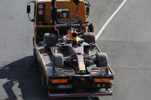 Marshals return the car of Max Verstappen, Red Bull Racing RB16, on a truck