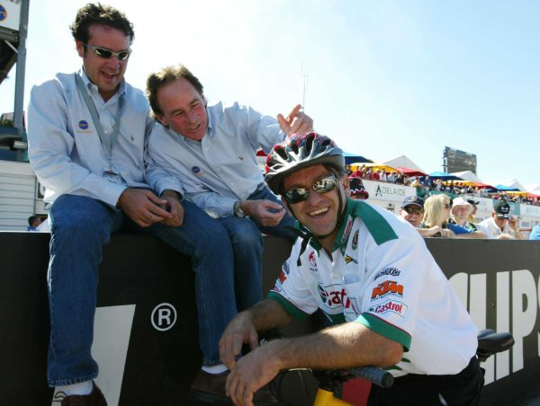2002 Australian V8 SupercarsAdelaide Clipsal 500. Australia. 17th March 2002.Holden driver Russell Ingall is given a hard time about being on two wheels by former World 500cc Champion Barry Shean and ex 500cc rider Darryl Beattie at the Clipsal 500.World Copyright: Mark Horsburgh/LAT Photographicref: Digital Image Only