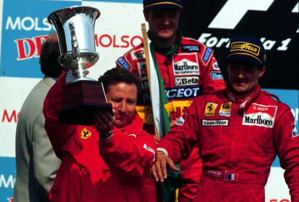 1995 Canadian Grand Prix.Montreal, Quebec, Canada.9-11 June 1995.Ferrari Team Principal Jean Todt lifts the Manufacturer's trophy after Jean Alesi's win.World Copyright - LAT Photographic
